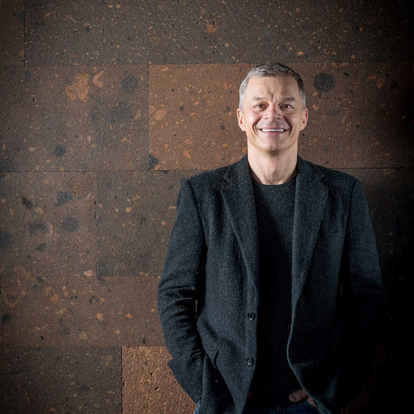 Rainer Becker standing and smiling